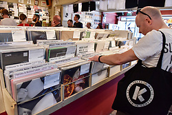 © Licensed to London News Pictures. 21/04/2018. LONDON, UK.  An analogue music fan browses records inside an independent record shop in Soho on the 11th annual Record Store Day.  Over 200 independent record shops all across the UK come together to celebrate the unique culture of vinyl music with special releases made exclusively for the day.  Photo credit: Stephen Chung/LNP