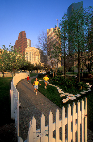 Stock photo of children running through a park in downtown Houston, Texas.