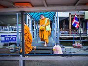 15 FEBRUARY 2015 - BANGKOK, THAILAND:  Buddhist monks board a cross river ferry at the flower market in Bangkok to go across the Chao Phraya River to the Kudeejeen neighborhood.      PHOTO BY JACK KURTZ