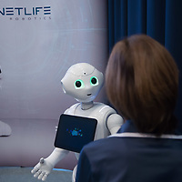 Woman interacts with a Pepper customer service robot that takes part in a press conference introducing the development plans of Hungary's Netlife Robotics company in Budapest, Hungary on Sept. 6, 2018. ATTILA VOLGYI