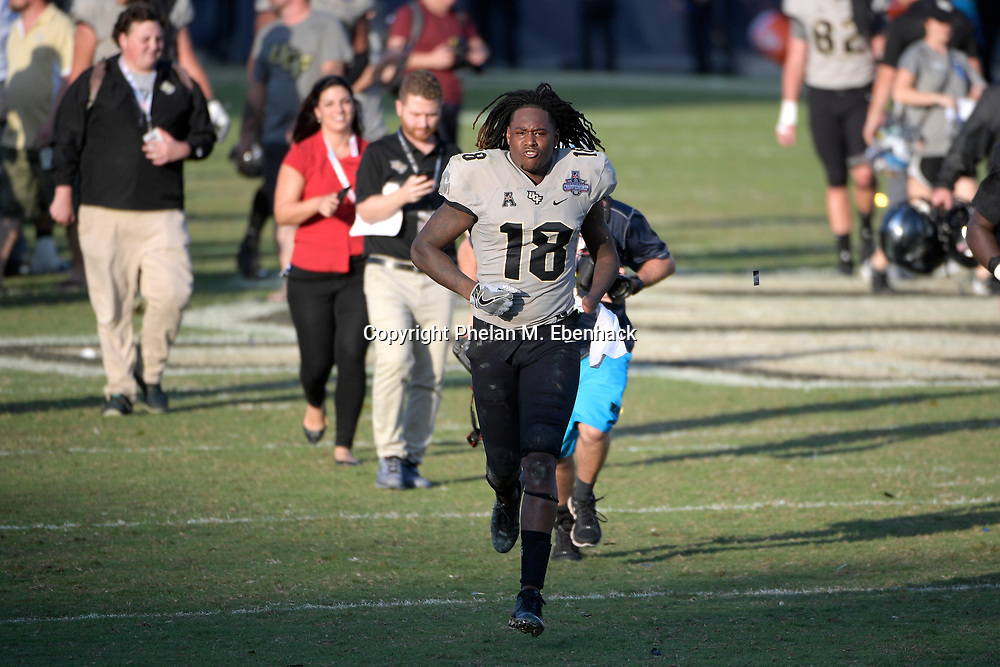 Central Florida linebacker Shaquem Griffin (18) runs off the field after the American Athletic Conference championship NCAA college football game against Memphis Saturday, Dec. 2, 2017, in Orlando, Fla. Central Florida won 62-55. (Photo by Phelan M. Ebenhack)