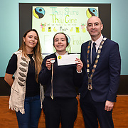 05/03/2019<br /> Pictured is 2nd prize award winner Katie Quinn, from Catherine McAuley School, along with Sara Montoya, co-op member of Fairtrade Colombia, and Cllr Daniel Butler, Mayor of the Metropolitan District of Limerick.<br /> <br /> Fairtrade worker Sara Montoya, from a Fairtrade Coffee Co-op in Colombia was the special guest in Limerick City and County Council chamber today at an event to coincide with Fairtrade Fortnight.<br />  <br /> Sara joined Fairtrade supporters from across Limerick and Ireland for the annual initiative, which features a programme of talks and community events aimed at promoting awareness of Fairtrade and Fairtrade-certified products.<br />  <br /> Speaking at the event in Dooradoyle, Sara outlined the success and benefits of the Fairtrade movement in Colombia and how important it is for people in the developed world think of Fairtrade products when shopping.<br />  <br /> This year's campaign 'Create Fairtrade' invites us all to use our imagination and create fairtrade in our lives.<br />  <br /> Young people from across Limerick city and county were also a focus of the event as they displayed their posters, which they created to help change the way people think about trade and the products on our shelves.<br /> Photo by Diarmuid Greene