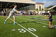 January 27 2016: New York Giants Eli Manning plays catch with a young fan during the Pro Bowl Draft at Wheeler Army Base on Oahu, HI. (Photo by Aric Becker/Icon Sportswire)
