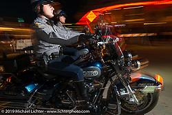 Daytona Beach Police cruise Main Street during Daytona Bike Week, FL, USA. March 9, 2014.  Photography ©2014 Michael Lichter.