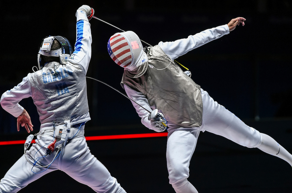 United States men's foil fencer Alexander Massialas, right, scored a point in the gold medal match Sunday against Daniele Garozzo of Italy, left, at the 2016 Summer Olympics Games in Rio de Janeiro, Brazil. Garozzo won the match and the gold medal, 15-11.