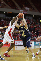 04 December 2010: John Wilkins puts a hwnd out trying to stop a leaping shot by Bobby Howard during an NCAA basketball game between the Montana State Bobcats and the Illinois State Redbirds at Redbird Arena in Normal Illinois.
