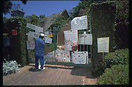 The OJ Simpson trial and media circus.<br /> A gang member leaving a sign on OJ's Simpson's home front gate.