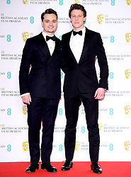 Dean-Charles Chapman and George MacKay in the press room at the 73rd British Academy Film Awards held at the Royal Albert Hall, London.