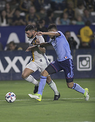 August 12, 2017 - Carson, California, U.S - Romain Alessandrini #7 of the Los Angeles Galaxy battles for the ball with Alexander Callens #6 of the New York FC during their MLS game on Saturday August 12, 2017 at StubHub Center in Carson, California. LA Galaxy loses to New York FC, 2-0. (Credit Image: © Prensa Internacional via ZUMA Wire)
