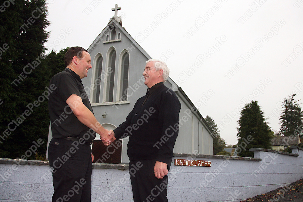 Fr. Ger Nash originally from Tulla now a priest working in Crusheen with Fr. Martin O' Brien originally from Crusheen and a priest working in Tulla meet at Knockjames church close to the parish boundaries before their sides go head to head next week. <br /><br />Photograph by Yvonne Vaughan.