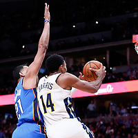 09 November 2017: Denver Nuggets guard Gary Harris (14) goes for the layup past Denver Nuggets forward Wilson Chandler (21) during the Denver Nuggets 102-94 victory over the Oklahoma City Thunder, at the Pepsi Center, Denver, Colorado, USA.