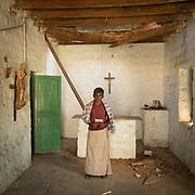 Man holding a Bible in an abandoned church near Hampi.