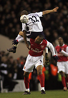 Photo: Paul Thomas.<br /> Tottenham Hotspur v Arsenal. Calring Cup, Semi Final 1st Leg. 24/01/2007.<br /> <br /> Julio Baptista (9) of Arsenal finds some extra baggage on his back in the shape of Beniot Assou-Ekotto.