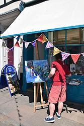 Man painting at Norwich Lanes Summer Fayre, July 2019, UK
