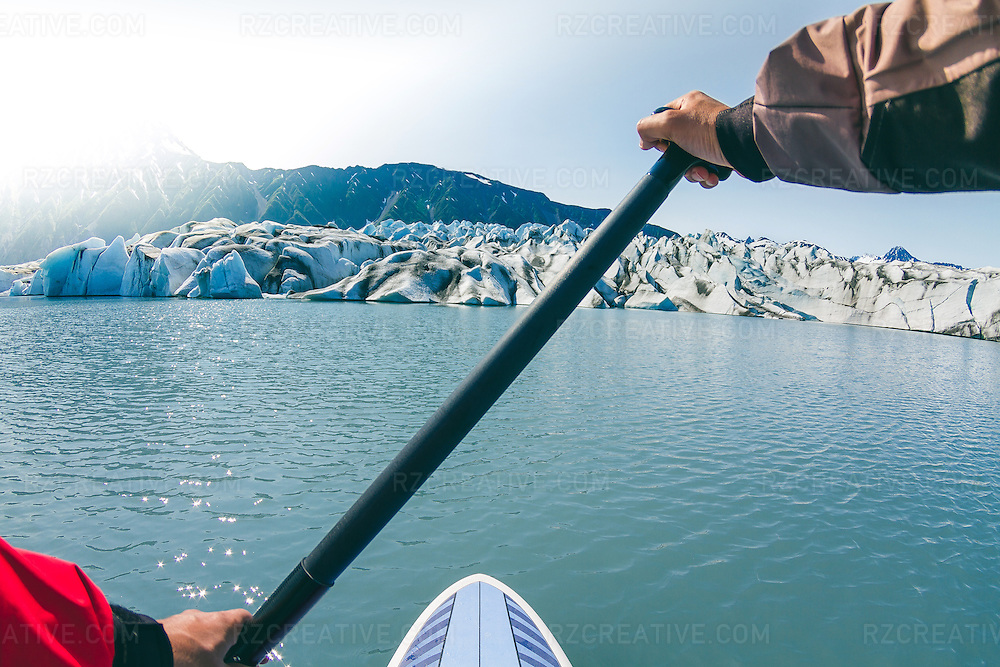 I captured this image of Bear Glacier in the Kenai Fjords National Park in Alaska. It was during a multi-day guided paddling trip in mid-July. We were fortunate to have beautiful clear weather this day. Using a wide angle lens and self-timer, I hung my 7D around my neck using the camera strap. I shot several images, this one having the best exposure and composition.