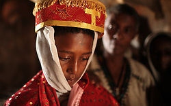 Destaye, 11, marries Addisu, 23, near Bahir Dar, Ethiopia on Feb. 4, 2008. Community members say that Destaye was married to Addisu at such a young age because, as a priest, it was necessary his bride be a virgin. According to the United Nations Population Fund, UNFPA, 37 percent of young women in sub-Saharan Africa aged 20 to 24 were married before turning 18. In 2010, there were 13.1 million girls married by age 18 in sub-Saharan Africa and the number is expected to rise to 15 million by 2030.