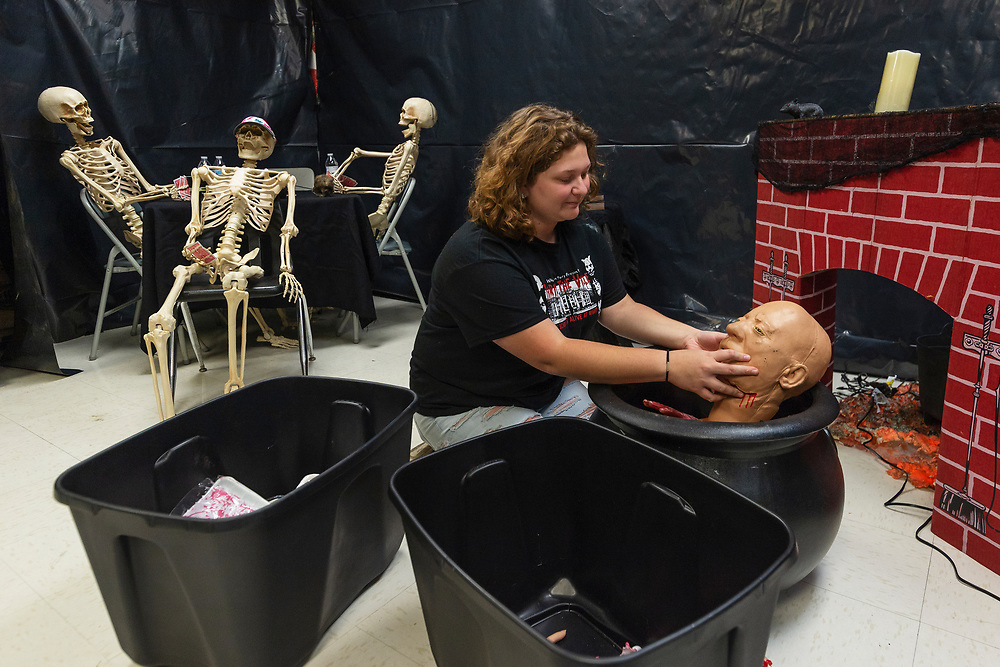 Heather Allen sorts through different ghoulish objects inside Whitesville Elementary school in preparation for the second year of Thrill at the Ville in Whitesville, W.V., on Friday, October 26, 2018. Thrill at the Ville is a haunted house created in the school by volunteers throughout the community that runs for two nights, with Saturday night being its last night. Around 900 people attended last year, and the volunteers hope to reach 1000. Tickets are $5 for kids and $8 for adults.