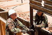 12 JUNE 2006 - SAN LUIS, AZ: Soldiers from the Utah Army National Guard drop a section of fence into place on the US/Mexico border Monday. Fifty five members of the 116th Engineer Company, Combat Support Engineers, of the Utah Army National Guard are in San Luis, AZ, to build a fence and improve roads east of the San Luis Port of Entry on the US/Mexico border. The unit is the first of an estimated 6,000 US military personnel, almost all of them Army National Guard, who will be dispatched to the US/Mexico border by President Bush to help control immigration on the border. The Guardsmen will primarily build roads and fence and staff surveillance centers. They will not be engaged in first line law enforcement work.  Photo by Jack Kurtz