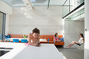 Jesse, 13, relaxing after school at home. His sister Mabel, 11 is on the sofa behind him and friend Abi, 11, sits on the swing at actor Jacob Krichefski's North London home, CREDIT: Vanessa Berberian for The Wall Street Journal. KRICHEFSKI, at actor Jacob Krichefski's North London home, CREDIT: Vanessa Berberian for The Wall Street Journal. KRICHEFSKI
