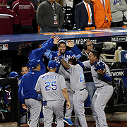Christian Colon, Kansas City Royals, is congratulated by team mates after scoring a run in the twelfth inning during the New York Mets Vs Kansas City Royals, Game 5 of the MLB World Series at Citi Field, Queens, New York. USA. 1st November 2015. Photo Tim Clayton