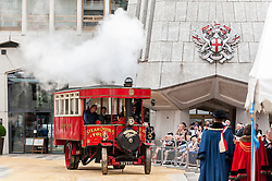© Licensed to London News Pictures. 15/07/2015. London, UK. A Foden steam-omnibus arrives in Guildhall during the historic Marking of Carts, which is run by The Worshipful Company.  Horse drawn carts, steam-powered and as modern modes of transport all received a branding as part of the ceremony.  Leading the ceremony were Sheriff Fiona Adler and Chief Commoner, Deputy Billie Dove OBE. Photo credit : Stephen Chung/LNP