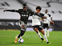 Football - 2020 / 2021 EFL Cup - Round 3 - Fulham vs Sheffield Wednesday<br /> <br /> Sheffield Wednesday's Fisayo Dele-Bashiru holds off the challenge from Fulham's Fabio Carvalho, at Craven Cottage.<br /> <br /> COLORSPORT/ASHLEY WESTERN
