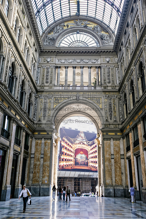 Interior of the Galleria Umberto I public shopping gallery looking out toward the San Carlo Opera House in Naples, southern Italy. Built between 1887–1891 by Emanuele Rocco.