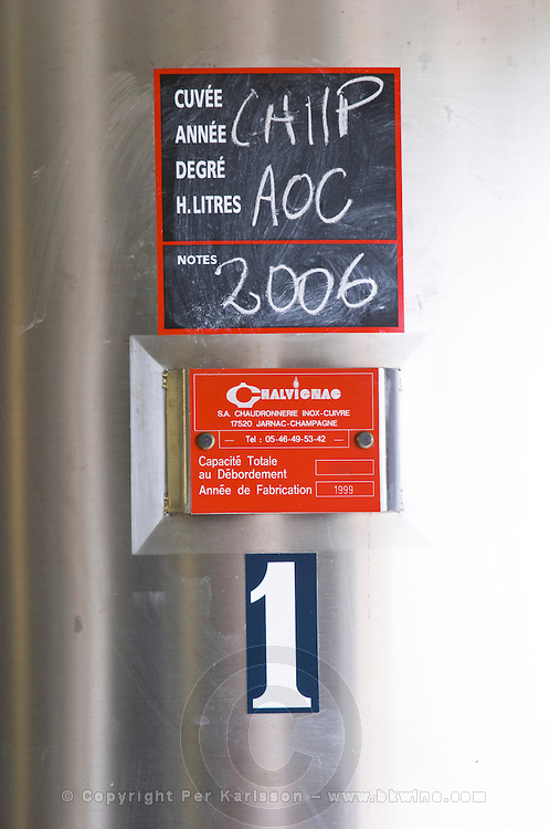Carignan AOC 2006. Domaine Alain Chabanon, previously Font Caude, in the Lagamas village. Montpeyroux. Languedoc. Sign on tank. Stainless steel fermentation and storage tanks. France. Europe.