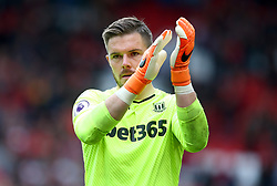 Stoke City goalkeeper Jack Butland applauds the fans at the end of the match