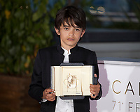 Actor Zain al-Rafeea with the trophy after director and actress Nadine Labaki won the Jury Prize for the film Capharnaum at the Award Winner's photo call at the 71st Cannes Film Festival, Saturday 19th May 2018, Cannes, France. Photo credit: Doreen Kennedy
