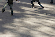 young male adults practicing there figure ice skating skills