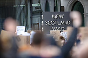 Demonstrators hold up placards as they gather outside New Scotland Yard in London on Sunday, March 14, 2021, during a protest over the abduction and murder of Sarah Everard and the subsequent handling by the police of a vigil honouring the victim. London's Metropolitan Police force was under heavy pressure Sunday to explain its actions during a vigil for Sarah Everard whom one of the force's own officers is accused of murdering. (VXP Photo/ Vudi Xhymshiti)