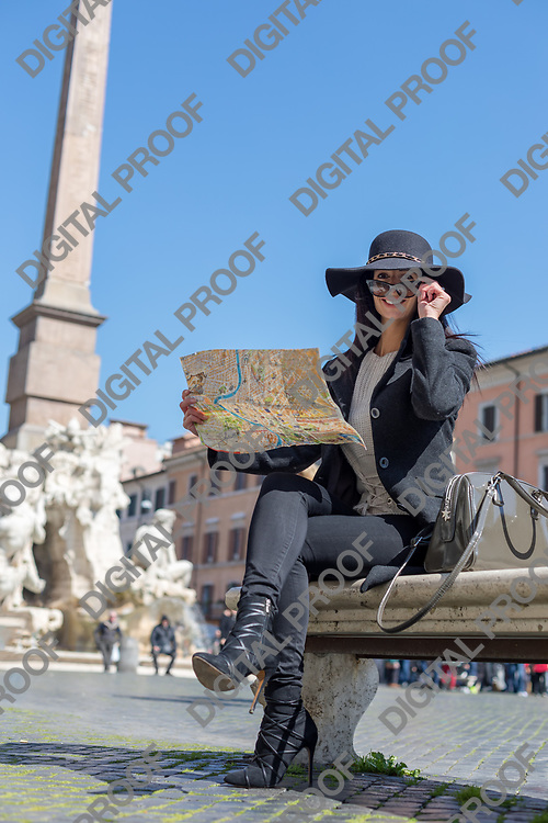 Happy Tourist woman hold  a map in piazza navoa looks the camera through sun glasses