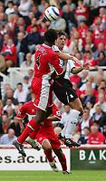 Fotball<br /> England 2005/2006<br /> Foto: SBI/Digitalsport<br /> NORWAY ONLY<br /> <br /> Middlesbrough v Liverpool<br /> Barclaycard Premiership.<br /> 13/08/2005.<br /> <br /> Liverpool's Fernando Morientes (R) battles with Middlesbrough's Ugo Ehiogu (L).
