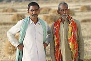 IND.MWdrv04.026.x..Ahraura Village, Uttar Pradesh, India. Bachau Yadav, 42 with his father. Ahraura Village, Uttar Pradesh, India. Revisit with the family, 2004. The Yadavs were India's participants in Material World: A Global Family Portrait, 1994 (pages: 64-65), for which they took all of their possessions out of their house for a family-and-possessions-portrait..