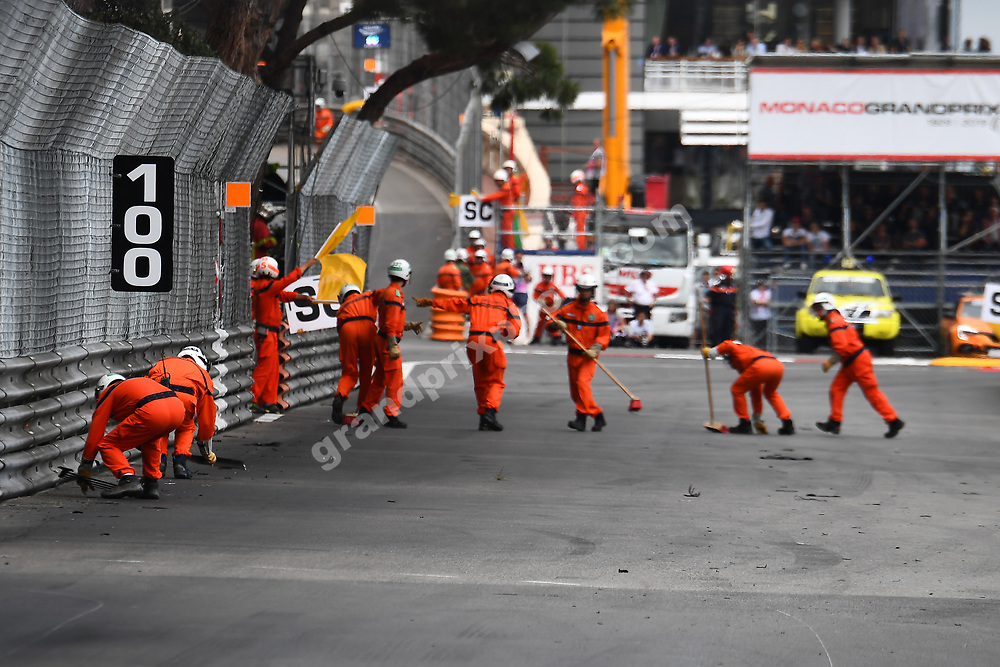 Marshals clean the track after Charles Leclerc (Ferrari) had a puncture during the 2019 Monaco Grand Prix. Photo: Grand Prix Photo