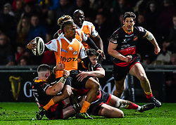 Cheetahs' Clayton Blommetjies is tackled by Dragons' Harrison Keddie and Arwel Robson<br /> <br /> Photographer Craig Thomas/Replay Images<br /> <br /> Guinness PRO14 Round 18 - Dragons v Cheetahs - Friday 23rd March 2018 - Rodney Parade - Newport<br /> <br /> World Copyright © Replay Images . All rights reserved. info@replayimages.co.uk - http://replayimages.co.uk