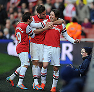 Arsenal's Thomas Rosicky ® celebrates after scoring his sides 3rd goal of the game with Arsenal's Santi Cazorla and Captian Mikel Arteta  during Barclays Premier League , Arsenal v Sunderland at the Emirates Stadium in London, England on Saturday 22nd Feb 2014.<br /> pic by John Fletcher, Andrew Orchard sports photography.