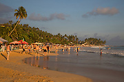 Crowded sandy beach at Mirissa, Sri Lanka, Asia
