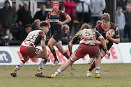 Matthew Screech of the Newport Gwent Dragons (r) gets ready to take the tackle from Ben Toolis of Edinburgh rugby with Michael Allen (L) of Edinburgh rugby looks on. Guinness Pro12 rugby match, Newport Gwent Dragons v Edinburgh Rugby at Rodney Parade in Newport, South Wales on Sunday 27th March 2016.<br /> pic by  Simon Latham, Andrew Orchard sports photography.