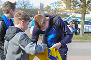 AFC Wimbledon striker Joe Pigott (39) signing fans shirt during the EFL Sky Bet League 1 match between AFC Wimbledon and Doncaster Rovers at the Cherry Red Records Stadium, Kingston, England on 9 March 2019.