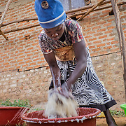 CAPTION: Namusisi is seen here doing laundry. Despite being hearing impaired and mute, she has found Damyano - whose impairments are very similar to her own - and the pair have married and now have two children. Through sign language, she shares that she leads a contented life, and attributes much of this to the help of SignHealth Uganda. LOCATION: Kankamba Village, Lwengo District, Central Region, Uganda. INDIVIDUAL(S) PHOTOGRAPHED: Namusisi Kato.