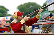 MEMBER OF THE FOOT REGIMENT OF THE SEALED KNOT SOCIETY FIRING A MUSKET IN THE ISLE OF MAN.