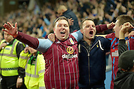 Aston Villa fans celebrate after Scott Sinclair of Aston Villa scores his sides second goal of the game to make it 2-0. The FA cup, 6th round match, Aston Villa v West Bromwich Albion at Villa Park in Birmingham, Midlands on Saturday 7th March 2015<br /> pic by John Patrick Fletcher, Andrew Orchard sports photography.