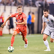 MEADOWLANDS, NEW JERSEY- August 7:   Marcos Llorente #18 of Real Madrid watched by Kevin Strootman #6 of AS Roma during the Real Madrid vs AS Roma International Champions Cup match at MetLife Stadium on August 7, 2018 in Meadowlands, New Jersey. (Photo by Tim Clayton/Corbis via Getty Images)