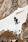 "To reach Paso Quadrado, we ascended steep snow using trailrunning shoes (but could have required crampons if icy), near El Chalten, in Santa Cruz Province, Argentina, Patagonia, South America. Initially, hike the scenic Rio Electrico Valley to Refugio Piedra del Fraile (""Stone of the Friar"", 14.5 km round trip). From the refuge, a path ascends very steeply to Paso Quadrado (gaining 1340 m vertically in 8.4 km round trip). Views keep improving the higher you go."