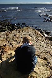 Boy gazing out to sea; Cullercoats; NE England