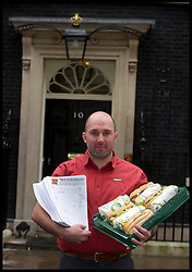 Harvey Brown from South west   joins subway owner David Cameron to deliver a petition to Downing Street from Subway, Tuesday January 22, 2013. Photo: Andrew Parsons / i-Images