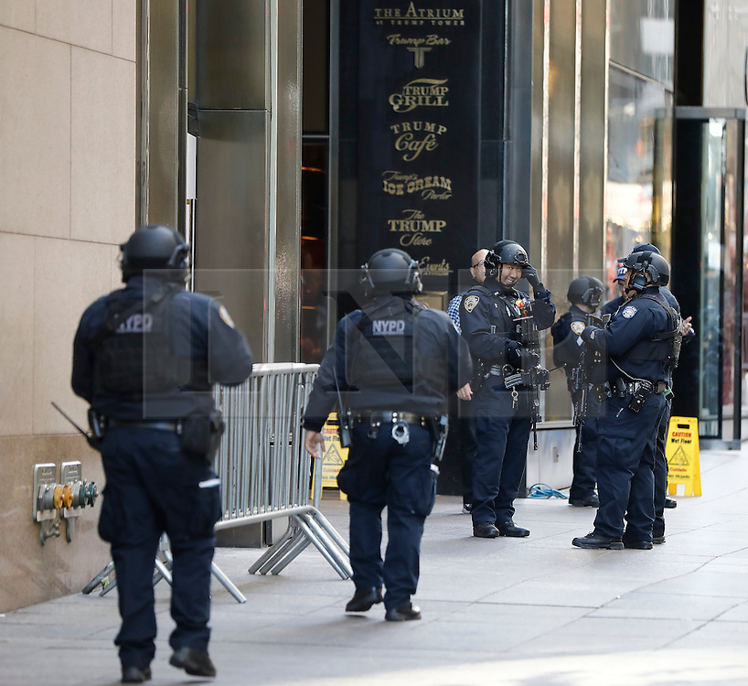 © Licensed to London News Pictures. 10/11/2016. New York CIty, USA. Armed New York police stand guard at the entrance to Trump Tower, the home of president-elect Donald Trump.  Protests have taken place outside Trump tower following a shock election victory by the controversial republican candidate earlier this week. Photo credit: Tolga Akmen/LNP