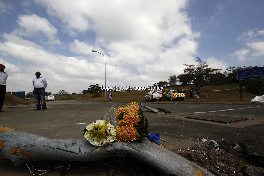 DURBAN - 6 September 2013 - A boquet of flowers placed by an unknown mourner on flattened traffic lights at the same intersection where 22 people were killed when a lorry crashed into four minibus taxis and a car. It had initially been reported that as many as 27 people were killed, but it was officialy confirmed on Friday that 22 were killed with scores more injured. Picture: Allied Picture Press/APP